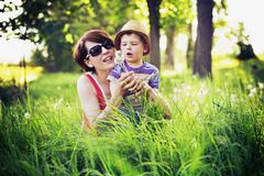 Colorful photo of mother and kid playing blow-balls Stock Photos