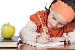 Adorable girl studying Stock Photos