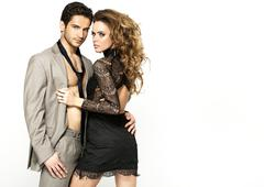 slim woman wearing nice dress and her stylish boyfriend - stock photo