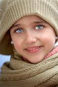 girl sheltered for the cold - stock photo