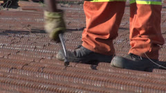 Tying Reinforcing steel civil construction PAL Stock Footage