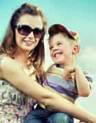 Attractive mom with her cute little kid Stock Photos