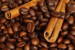 Coffee beans and cinnamon sticks Stock Photos