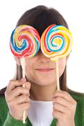 girl eating two lollipops - stock photo