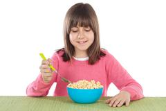 girl eating cereal - stock photo