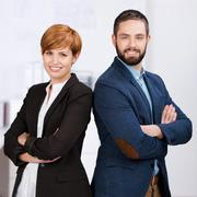 man and woman with arms crossed - stock photo