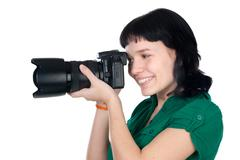 woman holding a photo camera - stock photo
