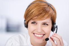Stock Photo of customer service executive speaking on headset