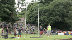 Tossing the sheaf at a Highland Games event Stock Footage