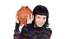 Stock Photo of casual girl with money box