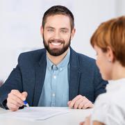 Businessman explaining documents Stock Photos