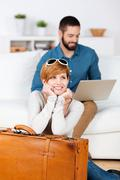 young couple planning a travel - stock photo