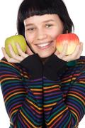 Stock Photo of a pretty woman holding  apples