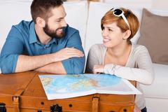 Young couple planning a travel Stock Photos