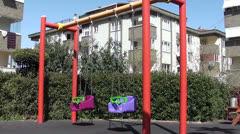 Empty swings near residential building Stock Footage
