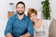 Portrait of happy couple at home Stock Photos