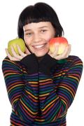 adolescent with apples - stock photo