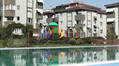 Swimming pool and childrens playground 2 Stock Footage