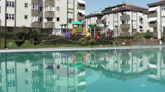 Swimming pool and childrens playground 3 Stock Footage
