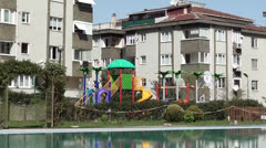Swimming pool and childrens playground zoom in Stock Footage
