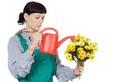 attractive happy woman dressed gardener - stock photo