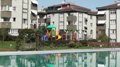 Swimming pool and childrens playground Stock Footage