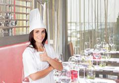 Pretty cook woman in her restaurant Stock Photos