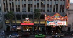 Ultra HD 4K El Capitan Disney Theatre, LA, Hollywood Night People Passing, Stars Stock Footage