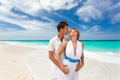Stock Photo of new married couple on beach