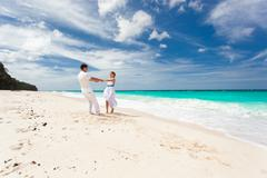 loving wedding couple on beach - stock photo