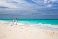 bride and groom on beach - stock photo