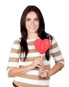 beautiful brunette girl with a big lollipop - stock photo
