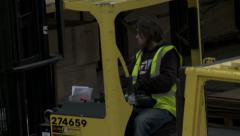Man driving Fork lift in a warehouse Stock Footage