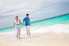 Bride and groom on beach Stock Photos