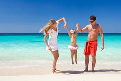 happy family having fun on beach - stock photo