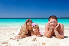 Stock Photo of happy family on tropic vacation
