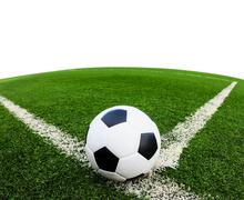 Soccer ball on green grass field isolated Stock Photos