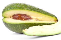 Whole avacado and slice Stock Photos