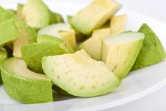 cutted avacado on plate - stock photo