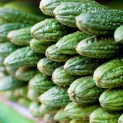 bitter melon (momordica charantia) fruit at asian market - stock photo
