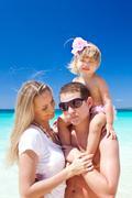 Happy family on tropic vacation Stock Photos