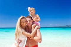 happy family on tropic vacation - stock photo