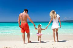 Happy family on tropic vacation Stock Photos