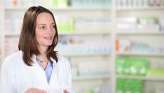 Happy female pharmacist - stock footage
