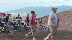 Boys start motorcycle race with parents help HD 8261 Stock Footage