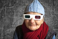 Elderly woman with anaglyph 3d glasses Stock Photos