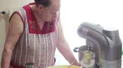 Old woman using machine to kneading dough for bread and pizza Stock Footage