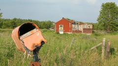 Wrecked mailbox and abandoned rural house. - stock footage