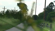 Stock Video Footage of watching a cyclist on a bike path through foilage