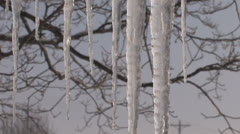 Icicles hanging from an awning Stock Footage